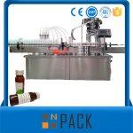 Αυτόματο μηχάνημα πλήρωσης υγρών με περιστροφικό μπουκάλι με κάλυμμα