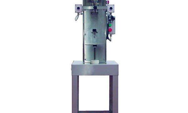 Ημιαυτόματο μηχάνημα καλύμματος φιαλών με άτρακτο